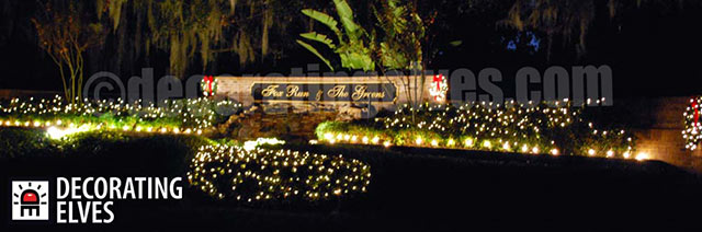 Commercial-Entrance-with-Wreaths-on-Sign,-Staked-Lighting-around-beds-and-minis-through-out-hedges-www.decoratingelves.com