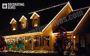 Residental-Holiday-Home-Roof-outlined,-minis-through-out-bushes-and-beds,-garland-swags-wreath,-www.decoratingelves.com