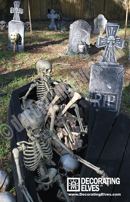 Halloween Skeletons in a Display with Coffin, Graveyard, Tombstone Décor, Skulls,