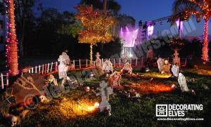 Commercial--Graveyard-Scene--Park-Setting-with-tombstones,-skeletons-and-wrapped-palm-trees-www.decoratingelves.com