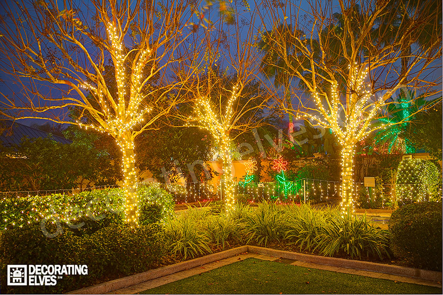 Crape-Mrtyles-in-a-garden-wrapped-with-mini-lights-www.decoratingelves.com