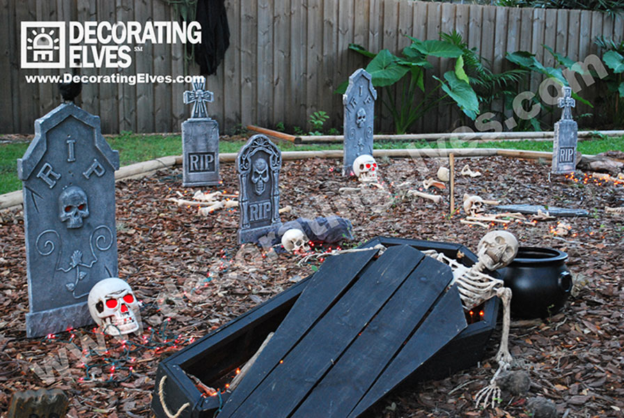 Halloween Décor with graveyard skeletons and coffin