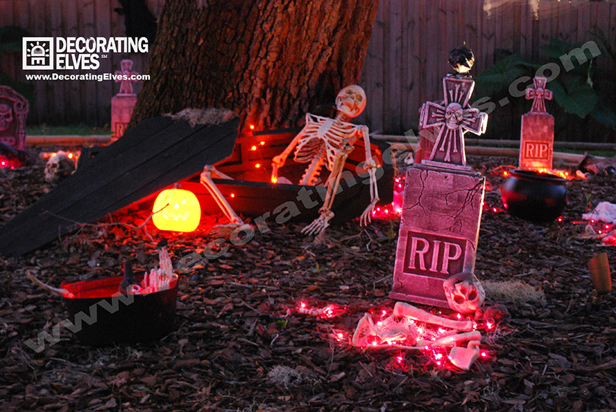 Halloween Lighted Graveyard Scene with Skeleton in a Coffin and Tombstones