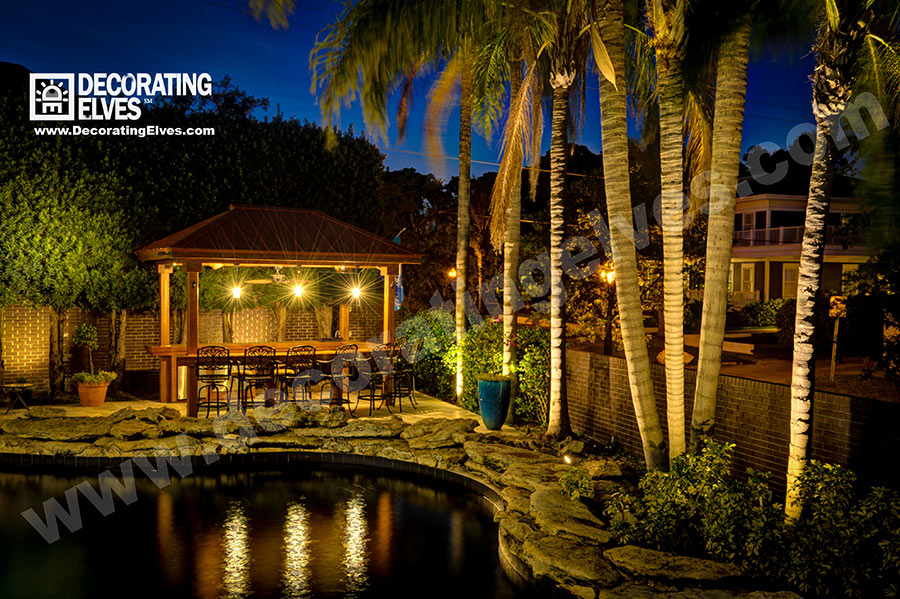 Outdoor-Cabana-Bar-Lighting--with-Palm-Lighting-and-Pool-Reflection-www.decoratingelves.com