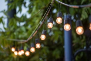 52376816 - hanging decorative christmas lights for a wedding ceremony