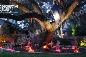 Graveyard-Scene-around-Large-Oak-Tree-with-Hanging-Ghost-and-skulls-on-a-limb-www.decoratingelves.com