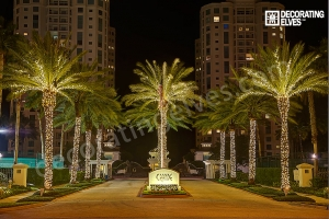 Entrance-with-LED-Warm-White-mini-trunk-wrap-and-fronds-www.decoratingelves.com
